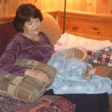 Mama Pam's lap - Gabby's MOST favorite place. - Pets Remembered