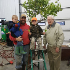Mason with nephew Kenneth Witt, and his sons Tilden and Emerson, and Mason's 78 year old grapefruit tree, November, 2016. - Douglas J Tomas