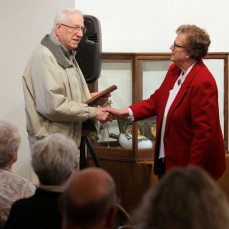 Mason Witt & Shirley Johnson, receiving a plaque of appreciation for years of service to Houston County Historical Society, November 2, 2014 - Douglas J Tomas