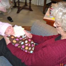 Joan greeting new grandson, Jack. - Carol Nilles