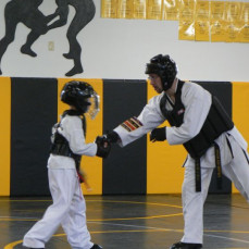 Master Menneke was willing to spar with a 8 year old so he could earn his black belt. Thanks Master Menneke, you were the best. Thanks for the