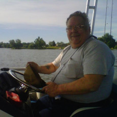 This is one of the best Pics of Dad.  Love of Fishing and wind blowing in his hair.  - Renee Lamberty