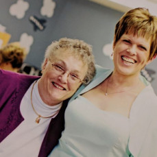 My mom asked me to post this one; it was taken at my wedding in 2011.  I'd never seen my grandma smile for a photo like this before! - Megan