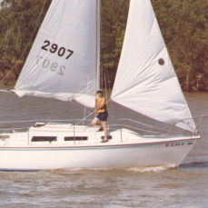"""Jack and Betty on the """"Bettina"""" after a thrilling sail (You can tell by the life vests and the double reefed sails!) at Kaw Lake. - Kevin Box"""
