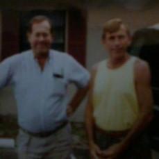 - Douglas left & his brother Ronald Pawasarat