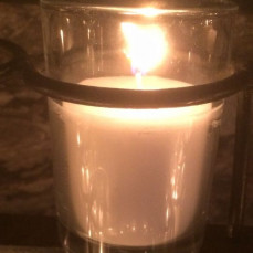 I was very sad to hear of Suzanne's death. She preceded me at Creighton and we had occasional contact over the years as we both became Sociologists. Here is a candle from the Notre Dame Grotto that was lit for her tonight. May she rest in peace and may God give strength to her loved ones. - Richard Williams