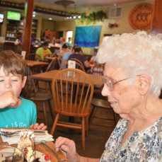 Mom and great grandson Max competing for ice cream (at 94th and 7th birthday party) - Irv Downing
