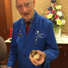 """I met Dr. Needham in the gift shop 3 years ago when I took my Dad there for surgery.  A little  wooden bowl caught my eye and as I was buying it Dr. Needham told me he """"made the bowl just yesterday"""".  I loved visiting with him and I asked if I could take his picture with the bowl.  I just wanted to share this picture with his family.  He was a special and amazing man.   - Susan Whiteside  Roberts"""