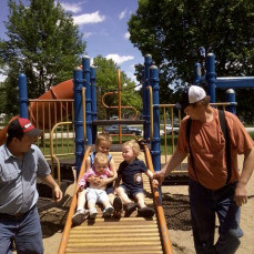 Keith and Chad with their kids at the park - Angela