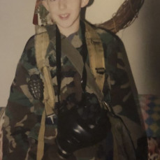 He used to love getting all dressed up in pilot and army gear; anything military. - Megan