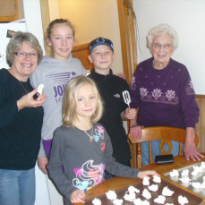 Grandma Zwiefel making Christmas divinity with Emma, Chandler and Betsy Kate.  - Jackie A Heiser