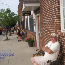 In earlier years Mike road a bike on the annual bike ride across Iowa, known as RAGBRAI. In later years as in 2011, he went along as biker support/driver and enjoyed visiting with many people along the bike route. Pedal on Mike! (Photos taken in 2011, RAGBRAI XXXIX) - Laughlin