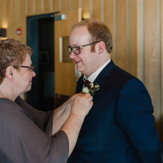 Marcia pinning Will's boutonniere at his wedding, January 2019 - Will Hoffman