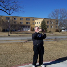 Prof. W taking a photograph. - Lori Muntz