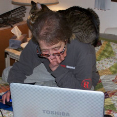 Boo-Boo liked to sit on Jody's shoulder when she was playing games on the computer. She loved games and played a lot of them on her phone also - Dorothy Parker