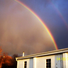 double rainbow in back of the truck garage - Dorothy Parker