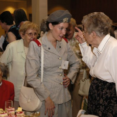It is hard to beat Dr. Calkin's description; Norma was a special person. I last visited Norma a few months ago and although her health was failing, the sparkle of laughter was still in her eyes. This is a photo of Norma instructing one of the models at the Historical Tea on how to where the cadet nursing uniform. - Coleen Southwell